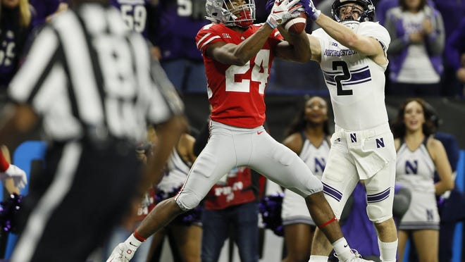 Ohio State Buckeyes cornerback Shaun Wade (24) intercepts a pass intended for Northwestern Wildcats wide receiver Flynn Nagel (2) in the endzone during the second quarter of the Big Ten Championship at Lucas Oil Stadium in Indianapolis on Dec. 1, 2018.