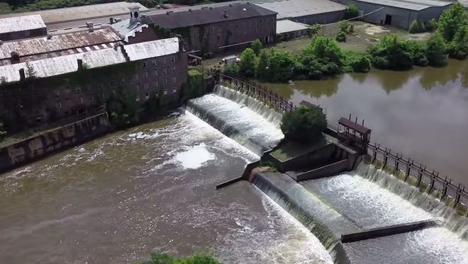 Drone view of the Pratt Cotton Gin is located in Prattville, Alabama on the banks of Autauga Creek at Heritage Park. Aerial video by SkyBama.com