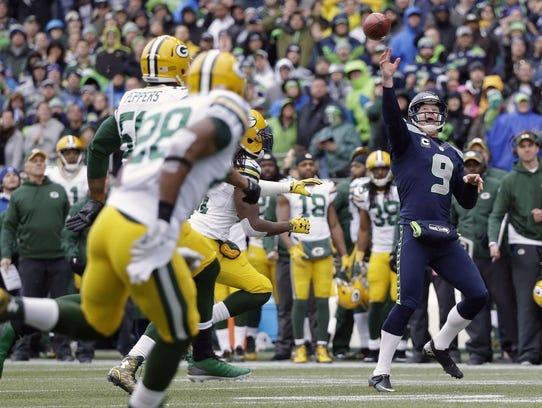 Seattle Seahawks' Jon Ryan throws a touchdown pass