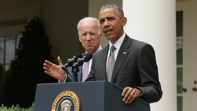 President Obama, flanked by Vice President Biden, gives a statement on the Supreme Court health care decision in the Rose Garden at the White House on June 25, 2015, in Washington. The Supreme Court upheld the Obama health care subsidies in a 6-3 ruling.