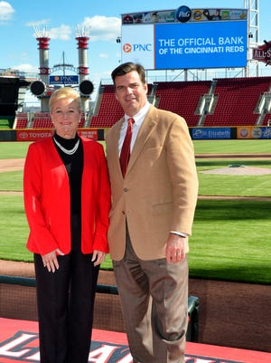 Kay Geiger, PNC's regional president in Cincinnati, and Phil Castellini, chief operating officer of the Reds, at Great American Ball Park.