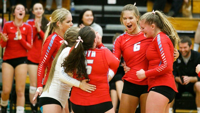 South Salem's Selbie Christensen (6) and teammates celebrate another point against West Salem on Oct. 9, at West Salem High School. Beginning next year, Salem-Keizer Schools will be in the same league as Bend schools.