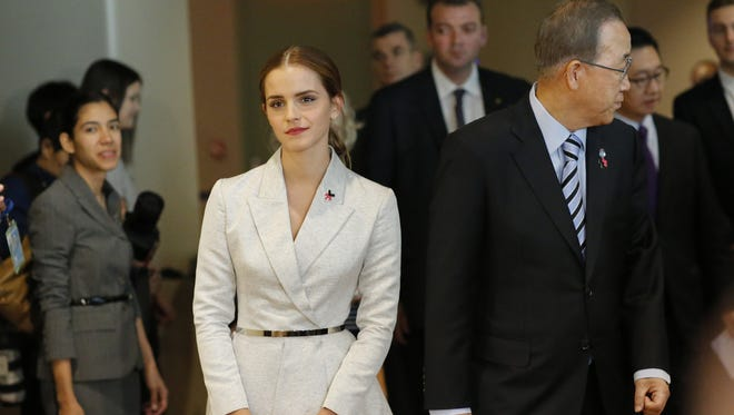 UN Women Goodwill Ambassador Emma Watson (C-Left ) walks next to United Nations Secretary General Ban Ki-moon, while they attend the HeForShe campaign launch at the United Nations on September 20, 2014 in New York, New York.