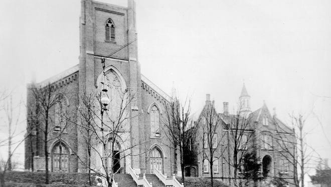 This undated photo shows the exterior of the St. Mary Cathedral  before the steeple was completed at the turn of the century. St. Ignatius Academy is seen at right.