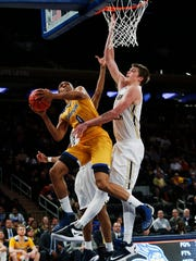 Cal State Bakersfield's Matt Smith (0) shoots around Georgia Tech's Ben Lammers during the second half of an NCAA college basketball game in the semifinals of the NIT Tuesday, March 28, 2017, in New York. (AP Photo/Kathy Willens)