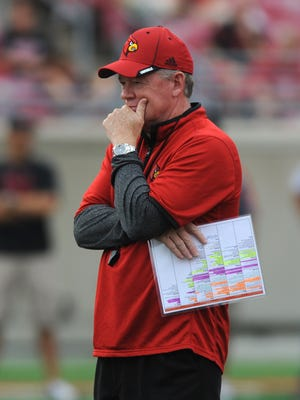 Louisville head coach Bobby Petrino watches his team during a scrimmage game on Saturday at Papa John's Cardinal Stadium. (By David Lee Hartlage, Special to the C-J) Aug. 16, 2014.