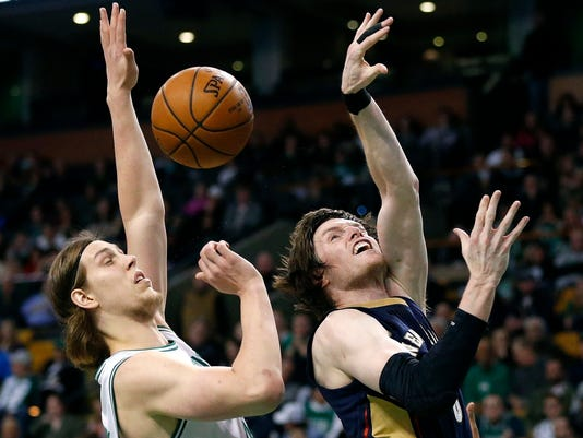 New Orleans Pelicans' Luke Babbitt, right, loses control of the ball while shooting against Boston Celtics' Kelly Olynyk, left, during the third quarter of an NBA basketball game in Boston, Wednesday, April 6, 2016. The Celtics won 104-97. (AP Photo/Michael Dwyer)
