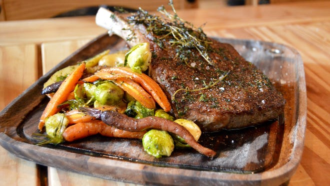 A bone-in rib eye steak, prepared Feb. 8 at Liquid Assets, would be a great for a Valentine's Day meal at home.