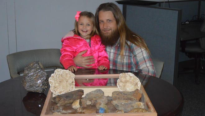 Josh Welch and his daughter Gwyn pose with the dinosaur  bones they found in Henderson and Hardin Counties.