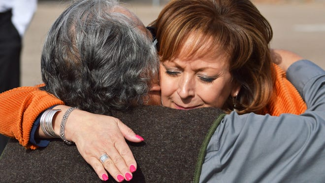 New Mexico Gov. Susana Martinez, right, hugs a family member of a victim of a drunken driving accident, during a press conference in Albuquerque on Tuesday, March 1, 2016. The Republican governor signed a bill Tuesday aimed at strengthening some drunken driving penalties. The bill makes it a second-degree felony to be convicted of eight or more DWIs, meaning tougher sentencing guidelines would be imposed. The measure also substantially increases penalties for convicted drunk drivers involved in fatal crashes.