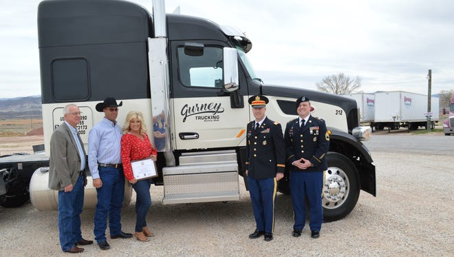 Utah state Rep. Carl R. Albrecht (from left), Gurney Trucking President Scott Gurney, Vice President Jodi Gurney, Salt Lake Army Recruiting Company Commander Capt. Andrew R. Ludlow and Provo Station Army recruiter Sgt. 1st Class John Belcher mark the new partnership between the Utah trucking company and the U.S. Army on April 19, 2018, in Aurora.