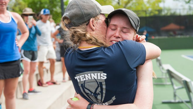 Poudre High School No. 1 singles player Ky Ecton embraces her sister Kayl Ecton after winning the match against Rock Canyon's Meghna Chowdhury during CHSAA 5A Tennis Finals Friday at Gates Tennis Center in Denver. Ecton won 6-4, 6-4.