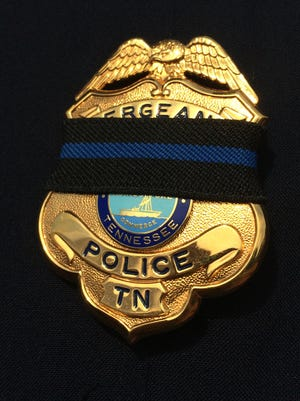 Area officers have been wearing the black band over their badges to express their sorrow at the loss of fellow officers last week.