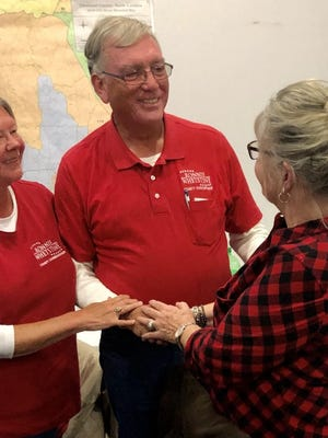 Ronnie Whetstine, who was re-elected as county commissioner, shakes a supporter's hand at the Republican head quarters Tuesday night.