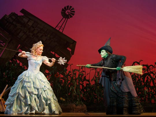 """Amanda Jane Cooper, left, as Glinda, and Jessica Vosk as Elphaba in the National Tour of """"Wicked,"""" the imaginative prequel to """"The Wizard of Oz."""" The show is a non-subscription presentation announced by Broadway in Cincinnati on Feb. 6. The production will be at the Aronoff Center Sept. 13-Oct. 15."""
