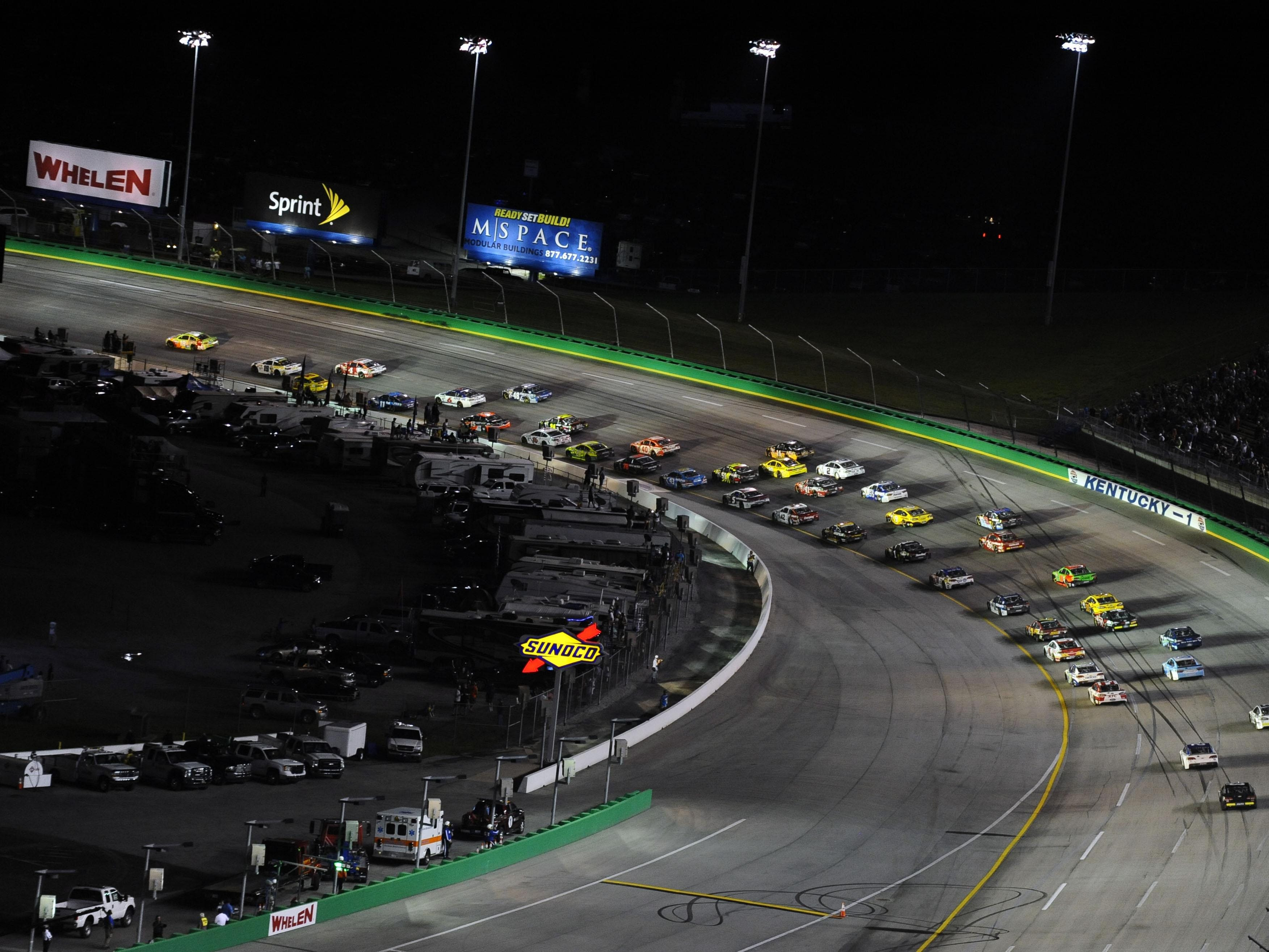 General view of the Kentucky Speedway as drivers take turn one during the Quaker State 400.