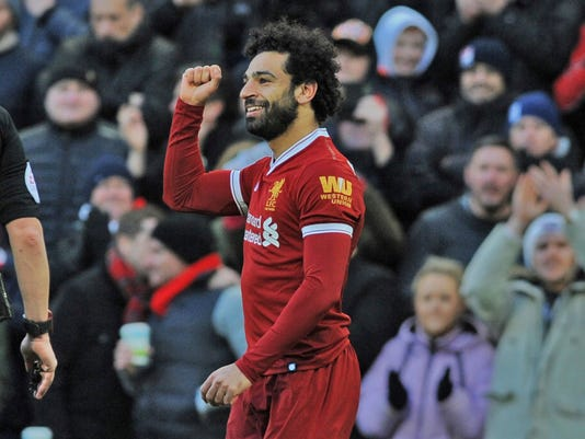 Liverpool's Mohamed Salah celebrates scoring his side's second goal of the game against West Ham, during the English Premier League soccer match between Liverpool and West Ham United at Anfield in Liverpool, England, Saturday, Feb. 24, 2018. (AP Photo/Rui Vieira)