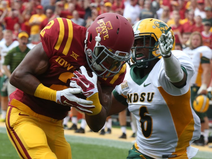 Iowa State's Aaron Wimberly runs the ball across the goal line as North Dakota State's CJ Smith reaches out to try and stop him. Iowa State played North Dakota State in their opening game Saturday, Aug. 30, 2014.