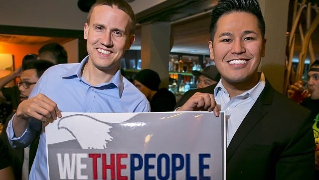 Neil Weare, left and Felix Sablan at a We The People event in San Diego. The group is working to give people living in the U.S. territories the right to vote for president.