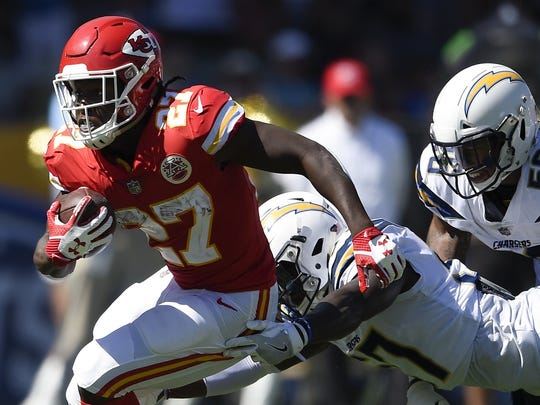 Sep 24, 2017; Carson, CA, USA; Kansas City Chiefs running back Kareem Hunt (27) runs the ball ahead of Los Angles Chargers inside linebacker Jatavis Brown (57) during the second quarter at StubHub Center.