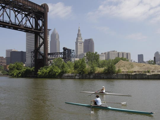 Federal environmental regulators say fish living in the northeast Ohio river through Cleveland that became synonymous with pollution when it caught fire in 1969 are now safe to eat.
