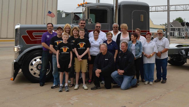 Pictured are Adam Vanderkin, David Vanderkin, raffle recipient. Kneeling are Jack and Steve Moss of Jack C. Moss Trucking, Lannon, 2015 WTNS Parade Marshals. Row two, from left, are Dan and Heather Vanderkin and some of the many WTNS committee members.