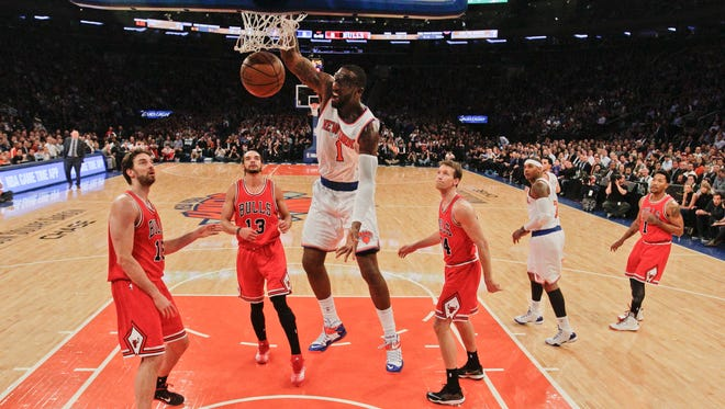 The Knicks' Amar'e Stoudemire had a strong first quarter, including this dunk in front of Chicago's Pau Gasol, but the Bulls routed the Knicks, 104-80 on Wednesday.