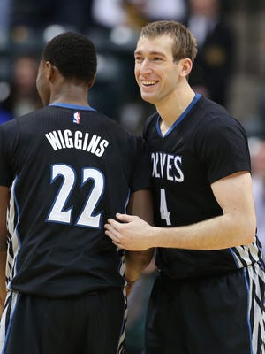 Minnesota forward and Purdue alumni Robbie Hummel celebrates their team win against the Pacers with teammate Andrew Wiggins at the end of the game at Bankers Life Fieldhouse on Tuesday, Jan. 13, 2015. The Pacers lost 101-110 to the Minnesota Timberwolves.
