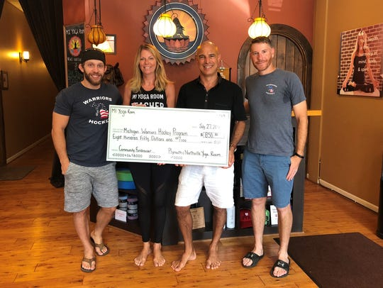 Michigan Yoga Room owners Sheri and Brent Rieli present