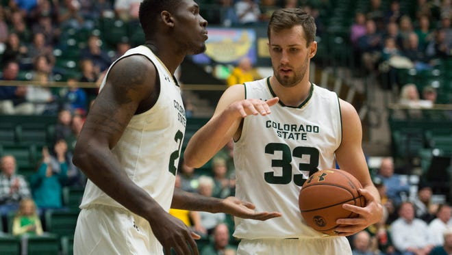 CSU center Braden Koelliker congratulates forward Emmanuel Omogbo after a dunk in a game against Southeastern Louisiana at Moby Arena Friday, November 25, 2016.