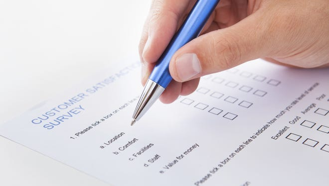 Person filling out a survey.