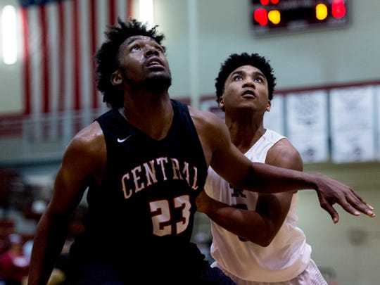 Central's Sean Oglesby (23) and Oak Ridge's levert Smith (5) eye a rebound ball during a game between Oak Ridge and Central at Oak Ridge in Oak Ridge, Tennessee on Friday, January 5, 2018.