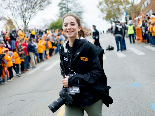 Caitie McMekin smiles during the Vol Walk ahead of