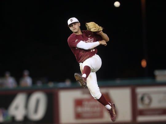 FSU's Mike Salvatore throws to first base for the out