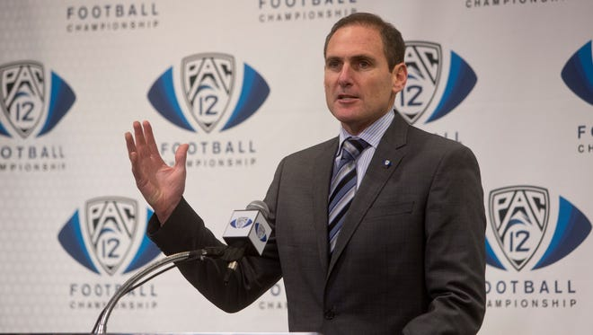 Pac-12 Commissioner Larry Scott, pictured in Tempe in December 2013, met with Pac-12 coaches in Phoenix on Wednesday, May 7, 2014.