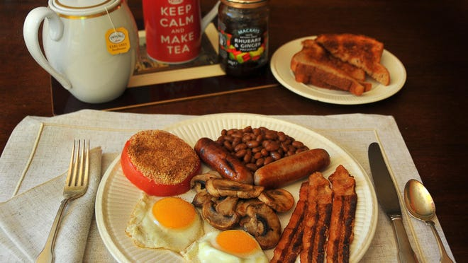 A Full English Breakfast includes eggs, bacon, bangers, mushrooms, baked beans, grilled tomato, toast and jam served with tea or coffee.