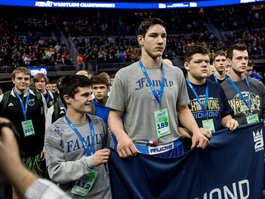 Richmond wrestlers participate in the champions' walk during the MHSAA individual wrestling finals Saturday, March 4, 2017 at The Palace of Auburn Hills.
