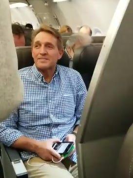 Ady Barkan asks Arizona Senator Jeff Flake about the tax bill on an American Airlines flight form Washington D.C. to Phoenix.