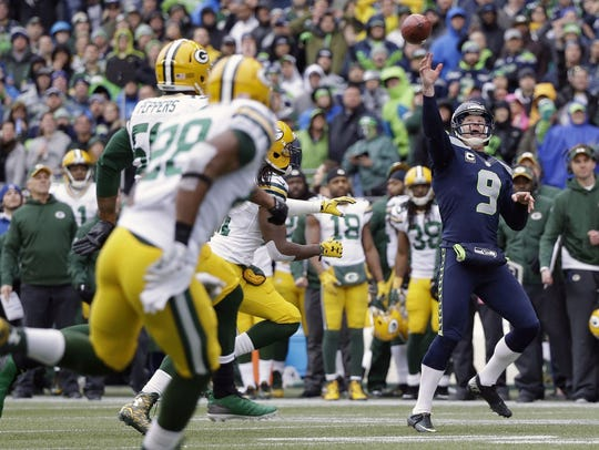 Seattle Seahawks' Jon Ryan throws a touchdown pass