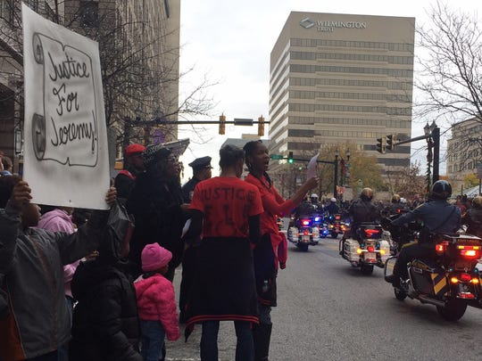 """Family and friends of Jeremy """"Bam"""" McDole used the Christmas parade to call for answers to the fatal September shooting of the 28-year-old man by Wilmington police."""