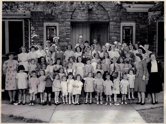 Children and adults gather  in 1941 in front of Harvey Brown Memorial Presbyterian Church's original building, 118 Bauer Ave., in St. Matthews.