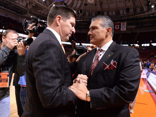 Clemson coach Brad Brownell (left) and USC coach Frank