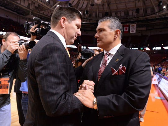 Clemson coach Brad Brownell (left) and USC coach Frank Martin