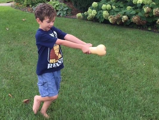 MTO fall festival - kid and squash