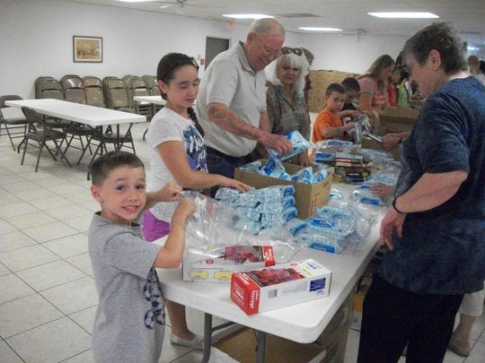 Volunteers packing care packages at St. John's Episcopal Church for Operation Soldier Smiles.