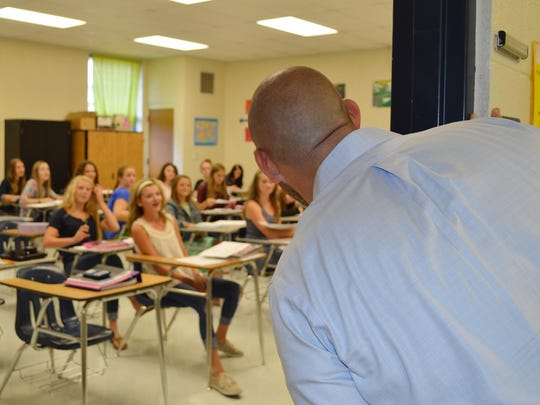 Dr. Jake Long pops into a class at Mountain Home Junior High.