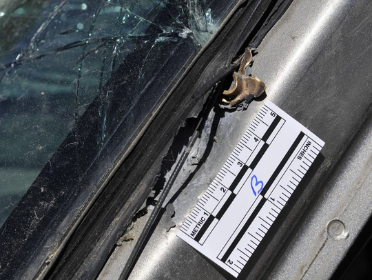 A photo showing one of the bullets on the pickup truck
