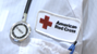American Red Cross badge on shirt of blood drive worker
