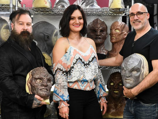 Glenn Hetrick, left, actress Mary Chieffo and Neville Page show off 'Star Trek: Discovery' alien sculptures at Alchemy Studios.