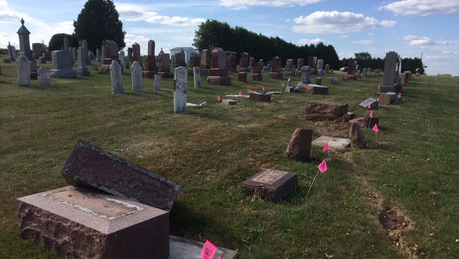 Grave markers in the Faith Lutheran Church cemetery in the village of Maine were damaged when an SUV crashed in July.